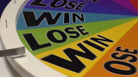 servet : Colorful colourful spinning wheel of fortune lands on Win. Stok Video