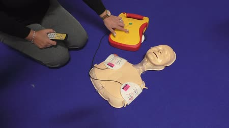 first aid kit : Health service training instructor demonstrating cardiopulmonary resuscitation or CPR training kit