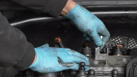 maska : Car mechanic working under bonnet or hood hands close up Wideo