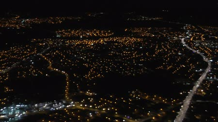 anglia : City lights at night from descending aircraft in flight before landing at Manchester airport, England, UK