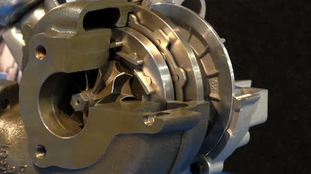 montaj : Diesel car engine cut open turbocharger showing working parts
