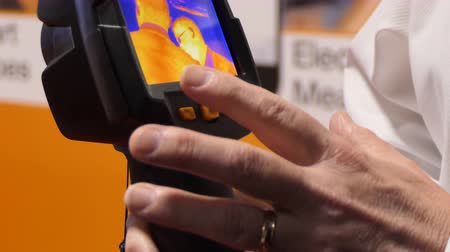 thermography : Businessman demonstrating portable thermal imaging camera