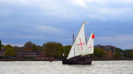 lanoví : Retro style wooden tall ship carrying flag of Portugal sailing on river Thames in London, UK
