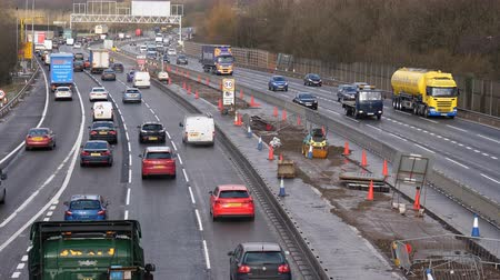 roadworks : MANCHESTER, ENGLAND, UNITED KINGDOM - MARCH, 2018: Closer view of heavy traffic on a part of Manchester city ring road under reconstruction. M60 is upgrading into smart motorway Stock Footage