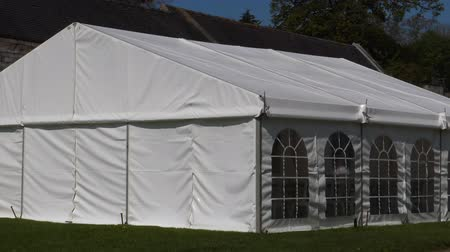 marquee : Big white tent or marquee with arched windows for entertainment, party or other event in the sunshine Stock Footage