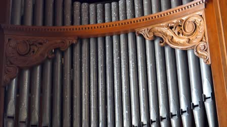 trubka : Old church organ instrument pipes tilt down shot
