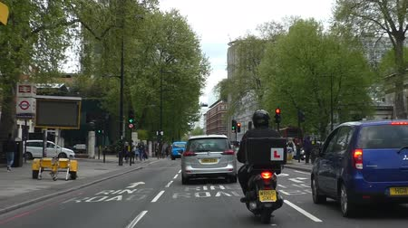 london cab : LONDON, ENGLAND, UNITED KINGDOM - APRIL, 2017: Driver point of view of Euston Road driving near station through traffic lights and speed camera markings