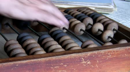 daň : Close up of hand of man counting finance using old style calculator, wooden abacus Dostupné videozáznamy