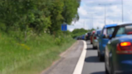 queue : Travelling in the country on a nice sunny summer day, stuck in traffic jam Stock Footage