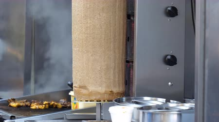 kebap : Doner kebab meat on spit is rotating on vertical rotisserie in takeaway shop or takeout restaurant Stock Footage
