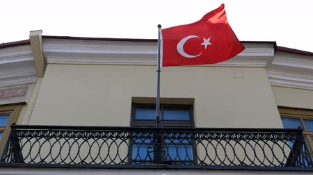 embassy : National red flag of Turkey flying slow in the balcony of the building