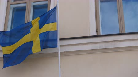 stockholm : Flag of Sweden waving slowly on the building wall Stock Footage