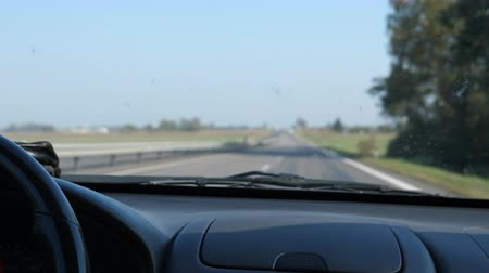 car interior : Blurred highway view from inside of moving car, dirt on windshield