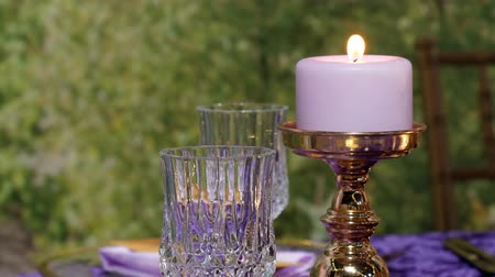 purpurový : Crystal glass and candle in dinner setting close up, copy space Dostupné videozáznamy