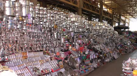кухонная посуда : Large kitchenware stall at Agadir city market in Morocco, handheld camera shot