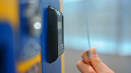 vending machine : CloseUp of Paying by a Credit Card using Paypass Reader on a Ticket Vending Machine with Terminal