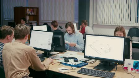 programmers : Group of Young Architects is Working at their Computers on Projects in the Office with OpenSpace Room Stock Footage