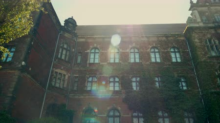 hera : Horizontal Panorama of Historic Building of Museum from Red Brick with Ivy and Sun Flare in Wroclaw, Poland