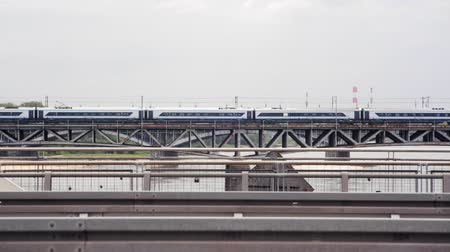 warszawa : Train Crossing the Vistula River in Warsaw. Fast Passenger Trains and Cars are Going over the Railroad Bridge