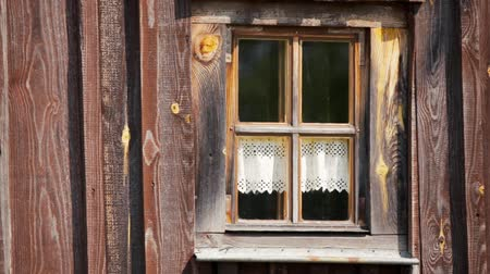bavorské : Outdoor View of a Cozy Beautiful Window with Curtain in a Rural Wooden Slavic Country House Dostupné videozáznamy