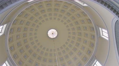 congress : POV Looking up to Dome inside Roman Catholic Church Building with sphere roof. Turning camera 360 around 4K Footage Stock Footage