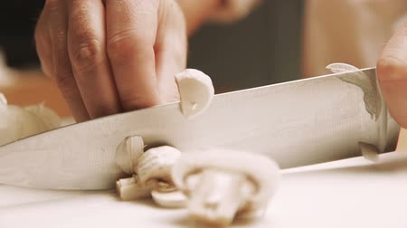 shiitake : Sliced mushrooms for cooking. The cook cuts mushrooms. Man preparing food