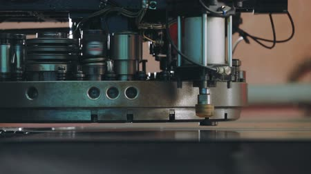 cutting up : Close up automated machine manufacturing. CNC Machine Produces Metal Detail on Factory.