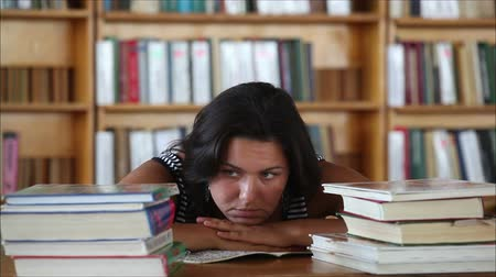 усталый : tired beautiful girl student in the library
