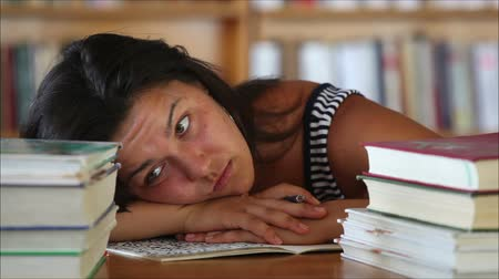 домашнее задание : tired beautiful girl student in the library