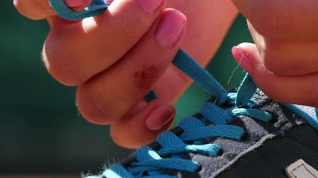 tying : Athlete trying running shoes getting ready for jogging slow motion Stock Footage