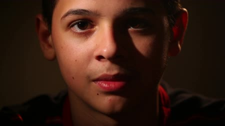 adolescentes : portrait of a teenager on a dark background 1