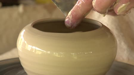 terrakotta : potter sculpts clay small pot