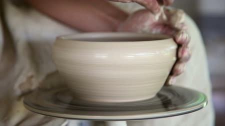 potter wheel : potter sculpts clay small pot