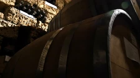 cerveja : Dolly shot of wine bottles and barrels in winery cellar
