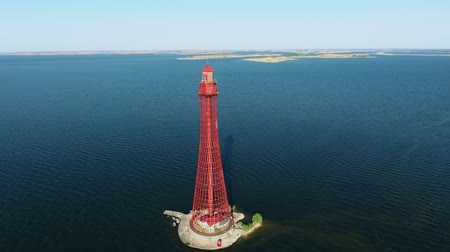 felhőtlen : An impressive bird`s eye view of the high red beacon from metallic lattice on the Black Sea shoal on a sunny day in summer. The sky is celeste.
