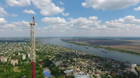 splendid : A breathtaking bird`s eye pan of the TV tower made of red and white grate, urban cityscape and the boundless Dnipro river on a sunny day