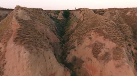 spiky : A bird`s eye view from a low flying drone of rough clay canyons and steep slopes of the Black Sea coastline hills on a sunny day in summer Stock Footage