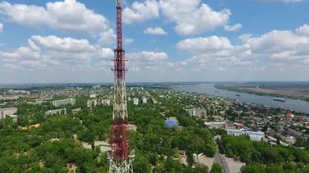 impressive skyline : An incredible bird`s eye pan of the lofty TV tower made of grate, green cityscape and the horizonless Dnipro river on a sunny day in summer