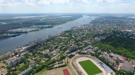 impressive skyline : A wonderful bird`s eye view of urban landscape covered with a big stadium, small houses, streets, and parks on the Dnipro bank in summer Stock Footage