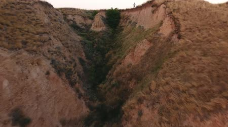 montanhoso : A bird`s eye view from a low flying drone of a rough sand gorge and abrupt slopes of the Black Sea coastline peaks on a sunny day in summer