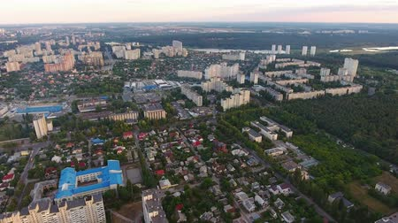 předměstí : A stunning bird`s eye view of a housing estate in Kiev full of high and small business and private houses, sport facilities in summer