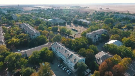 rural area : Wonderful bird`s eye shot of Askania-Nova with its sports grounds, tidy meadows, wide streets, and apartment blocks on a sunny day in summer.