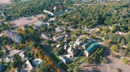 estreito : Amazing bird`s eye shot of Askania-Nova with its green parks, small houses and narrow streets on a sunny day in summer. It is the center of bio reserve