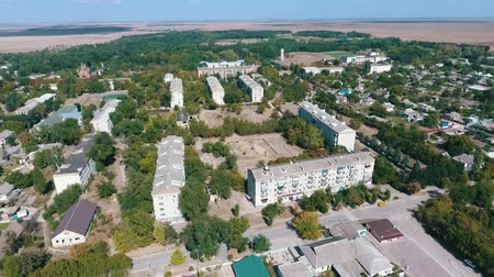bird sanctuary : Splendid bird`s eye shot of Askania-Nova settlement, the center of Oleshky steppe biosphere reserve with a lot of houses and paks in summer Stock Footage