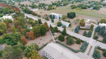 çimenli : Impressive bird`s eye view of a straight highway with several multistoried buildings and park zones around it in Ukraine in a summer day