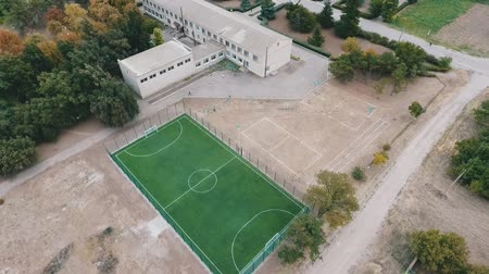 administracja : Wonderful bird`s eye view of a modern green football field  with an administrative two-storey building nearby in Ukraine in summer