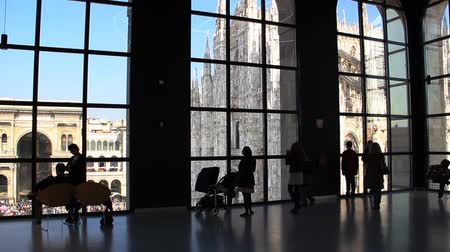 milan : Tourists looking at the duomo through a window in Milan