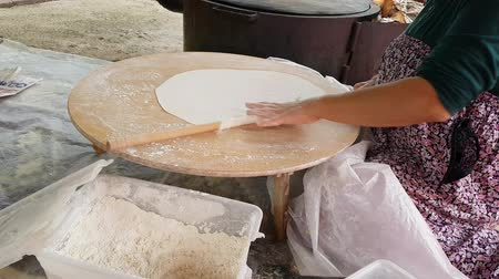 Turkish woman prepares Crepe - Gozleme, traditional turkish food. Stock Footage