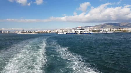 racek : Panoramic view of Karsiyaka and Izmir city on a steamboat. Seagulls flying on the sea.