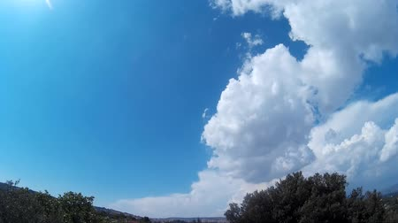 alguns : time lapse of blue sky with clouds running driven by wind